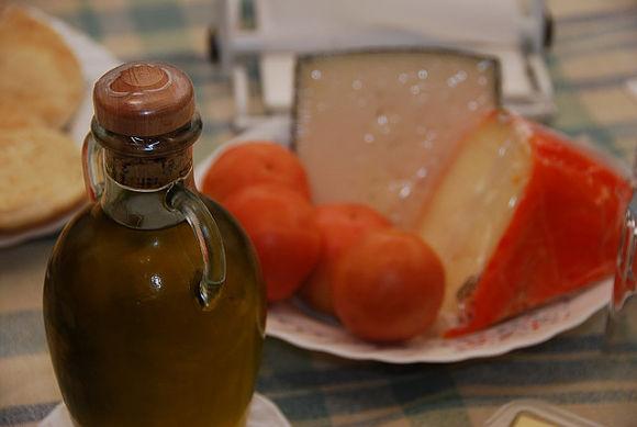 Un buen pà amb oli siempre lleva aceite de oliva virgen de Mallorca