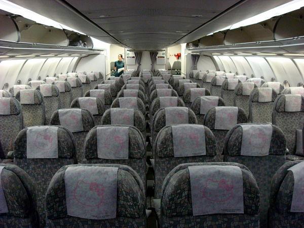 viajar primera clase asientos turista